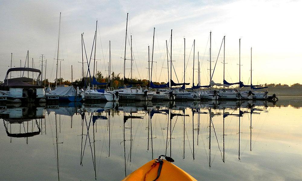 boats in lake c marina at sunset